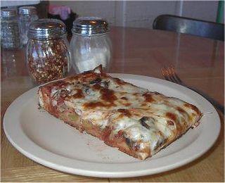 A slice of Conans Pizza